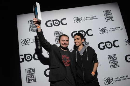 Matt Davis (left) and Justin Ma accept an award at GDC.