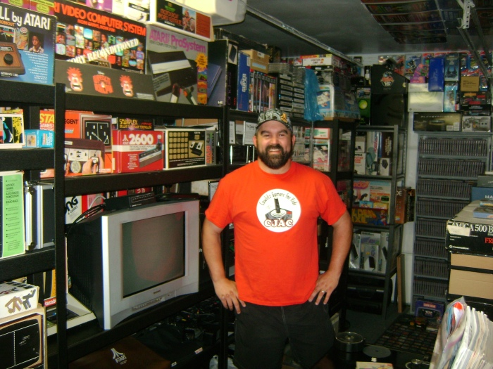 John Hancock strikes a pose with his collection. He keeps a CRT television plugged in to enjoy classic games.