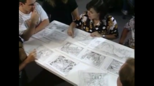 Jane Jensen (top, center) confers with a team of artists to create storyboards for King's Quest VI. (Photo credit:
